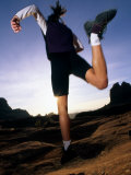 Woman Running on Slickrock, Sedona, Arizona Photographic Print by Kate Thompson