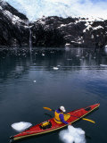 Woman Sea Kayaking Past an Ice Floe, Prince William Sound, Gulf of Alaska Photographic Print by Kate Thompson