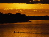 Water Taxi Ferries People across the Madre De Dios River at Sunrise Photographic Print by Maria Stenzel