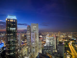 Night Scene of the Skyline in the Business District of Singapore, Singapore Photographic Print by  xPacifica
