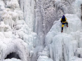 Ice Climber Climbing a Frozen Waterfall, Tangle Creek, Rocky Mountains, Canada Photographic Print by Kate Thompson