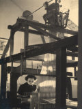 Young Woman Working at a Loom in a Workshop Photographic Print by Ludovico Pacho