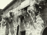 Old House with Mats in the Place of Shutters, Windows with Flowers, Orvieto Photographic Print by Vincenzo Balocchi