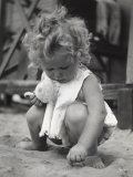 Baby Girl Playing with Sand Photographic Print by A. Paoletti