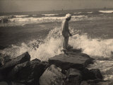 Fisherman Working on the Rocks Photographic Print by Ludovico Pacho