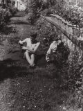 Young Woman Sun Bathes Nude in a Garden Photographic Print by Vincenzo Balocchi