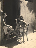 Two Girls Sitting on a Doorstep Photographic Print by Ludovico Pacho
