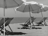 Sun Umbrellas and Lawn Chairs on a Beach Photographic Print by Vincenzo Balocchi