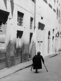 Elderly Woman in a City Street Photographic Print by Vincenzo Balocchi