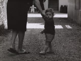 Baby Taking a Walk Photographic Print by Vincenzo Balocchi