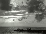 View of the Sea with a Group of Fishermen Intent on Fishing on the Reef Photographic Print by Vincenzo Balocchi