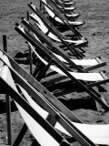 Lawn Chairs on a Beach Photographic Print by Vincenzo Balocchi
