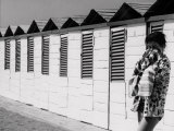 Girl on the Beach in Front of the Bathing-Huts Photographic Print by Vincenzo Balocchi