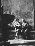 Two People Sitting in a Church Photographic Print by Luciano Ferri