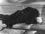 Man in Overcoat and Hat, Sleeping on a Public Bench Photographic Print by Vincenzo Balocchi