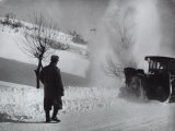 Man with His Back to the Camera on a Snow-Covered Street Watching a Snow Plow in Operation Photographic Print by A. Villani