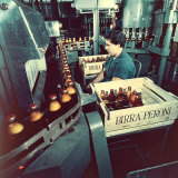 Peroni Factory, Worker Operating a Machine That Moves Bottles Full of Beer Photographic Print by A. Villani