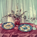 Table Covered with Red Satin, a Silver Candelabra, a Copper Pitcher and Two Colorful Plates Photographic Print by A. Villani