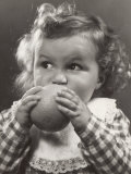 Little Girl Taking a Bite Out of an Orange Photographic Print by A. Villani