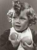 Little Girl Holding Two Oranges in Her Hands Photographic Print by A. Villani