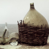 Demijohn and Glass Flasks Left on the Seashore Photographic Print by Vincenzo Balocchi
