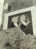Advertising Poster Affixed to a Wall with a the Image of an Elderly Couple with Glasses in Hand Photographic Print by Vincenzo Balocchi