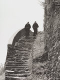 Monks Go Up a Stairway in Stone Photographic Print by Vincenzo Balocchi