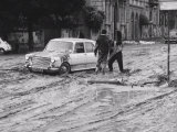 Automobiles Still Stuck in the Mud after the Flood in Florence Photographic Print by Vincenzo Balocchi