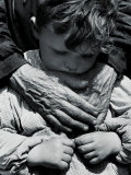 Child Dressed in a Preschool Pinafore with the Hands of an Elderly Woman Draped across His Chest Photographic Print by Vincenzo Balocchi