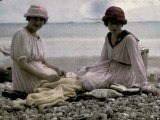 Two Women Sitting on the Beach Photographic Print by Henrie Chouanard