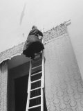 Priest Goes Up a Latter to Arrange the Curtains Photographic Print by Vincenzo Balocchi