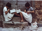 Two Children Playing with Dolls on the Steps of a House Photographic Print by Vincenzo Balocchi