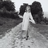 Model Wearing a Raincoat on a Country Road Photographic Print by A. Villani