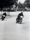 Two Motorcyclists Racing Along a Road, Otorcycles are Numbered 46 and 36 Photographic Print by A. Villani