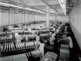 Interior of a Textile Factory, Numerous Workers in White Smocks are Packing Large Reels of Thread Fotodruck von A. Villani