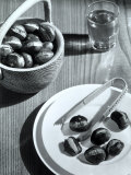 Plate and a Wooden Basket with Roasted Chestnuts Next to a Glass of Wine Photographic Print by A. Villani