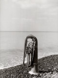 Trombone Resting on the Rocks at the Edge of the Sea Photographic Print by Vincenzo Balocchi