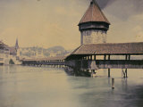 The Old Wooden Bridge Flanked by the Water Tower in Lucern Photographic Print by Henrie Chouanard