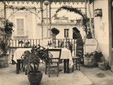 Woman Looking Out onto the Terrace of a Restaurant Photographic Print by Ludovico Pacho