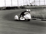 Two Motorcyclists in a Race, on a Two Seater Motorcycle Photographic Print by A. Villani