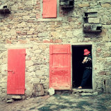 Woman with a Rabbit in Her Arms Leaning on the Jamb of a Door in a Stone Farmhouse Photographic Print by A. Villani