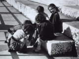Group of Children Playing in the Street, Sitting on Some Steps Photographic Print by A. Villani