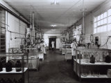 Three Technicians Working in the Laboratory of the Naarden Leepen Factory Photographic Print by A. Villani