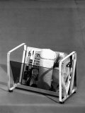 Model of a Magazine Rack by the Mascagni Furniture Company in Bologna Photographic Print by A. Villani