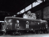 Locomotive under Construction in a Shed where Technician is Busy Installing the Motor Photographic Print by A. Villani