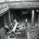 Column Pulled Down by Workers in the Atrium of Palazzo Hierschel in Trieste Photographic Print by Marion Wulz