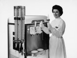 Woman in White Smock Shows the Ice Cream Produced by a Carpigiani Machine Behind Her Photographic Print by A. Villani