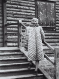 Model Posing on the Steps of a Mountain Chalet Wearing a Light Colored Fur with Dark Stripes Photographic Print by A. Villani