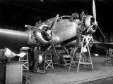 Group of Technicians Building an Airplane Inside a Hangar of Caproni Factory Photographic Print by A. Villani