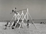 Group of Children Playing on a Swing on the Beach Photographic Print by A. Villani